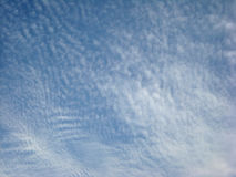 Cloud Cover. Morning light accentuates the cotton like texture of a thin cloud layer in the sky stock photography