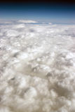 Cloud Cover Blue Sky Stratosphere Vertical Composition Clear Weather. Vertical composition blue sky and fluffy high clouds Royalty Free Stock Photo
