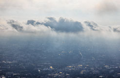 Cloud cover city. Natural phenomenon in morning, Cloud floating ablove city Royalty Free Stock Image