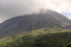 Cloud covered Arenal volcano national park in Costa Rica Royalty Free Stock Images