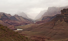 Cloud Covered Grand Canyon. Clouds cover the red layers of the Grand Canyon Stock Images