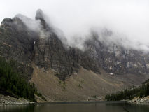 Cloud Covered Mountain Peaks. In banff national park in the Rocky mountains Royalty Free Stock Photo