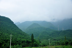 Cloud covered mountains Stock Images