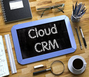 Cloud CRM Handwritten on Small Chalkboard. 3D. Royalty Free Stock Image