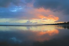 Cloud curtains open. Sunrise through the clouds at Hervey Bay Stock Photo
