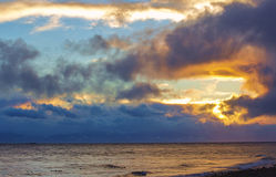 Sunset Clouds on the North Pacific. Cloud like a dragon breathing fire over the ocean Royalty Free Stock Photos