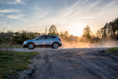 Cloud of dust behid a car. Driving through a dry unmade road Stock Images