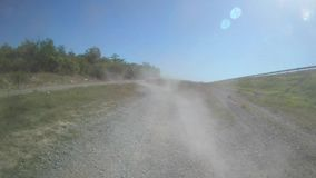 Cloud of dust over a rural dirt road. Cloud of dust over a road in the middle of vine, rows of vine, countryside stock footage