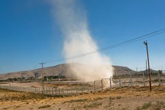 Cloud of dust and sand, raised by tornado off the road somewhere in the mountains of the Middle East Stock Photo
