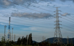 Cloud with electric tower. Electric tower with cloud and blue sky before sunset Stock Photos