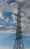 Cloud with electric tower. Electric tower with raining cloud and sky before sunset Royalty Free Stock Photos