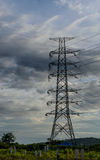 Cloud with electric tower. Electric tower with raining cloud and sky before sunset Stock Images