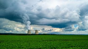 Cloud factory. Green, storm, rain, industry, nuclear, tower, technology royalty free stock photography
