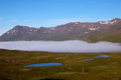 Cloud on the fjord, Iceland Stock Photo