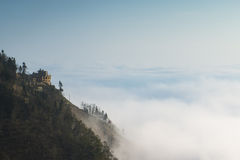 Cloud and fog shrouded mountains Stock Images