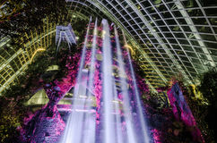 Cloud Forest Dome at Garden by the bay. Singapore – 25 March 2016: Tropical mountain along with plants and water fall in Cloud Forest Dome at Garden by the Stock Photos