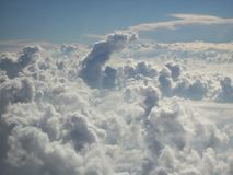 Cloud Formation Above Nevada Desert 2. Cloud formation above the Nevada desert near Las Vegas, as seen from a plane flying just above the clouds. The mushroom royalty free stock photos