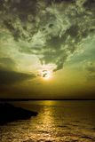 Cloud formation over sunset. Sinister cloud formation over sunset at Long Lake National Wildlife Refuge, Moffit, ND Stock Photo