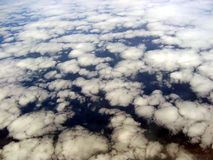Cloud formations aerial view. Aerial view of white cloud formations in sky pictured from aircraft Stock Photography