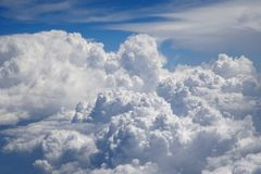 Flying above the clouds at 30,000 ft royalty free stock image