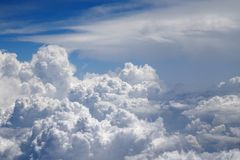 Flying above the clouds at 30,000 ft Stock Photos