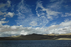 Cloud formations over lake and mountains. Ladakh, India Royalty Free Stock Photography