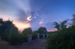 Cloud formations and stone bridge at sunset Royalty Free Stock Photos