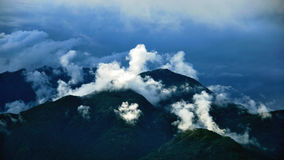 Cloud formations in Swiss mountains (Ticino). Clouds are gathering in the Swiss mountains near the city of Locarno (Ticino Royalty Free Stock Images