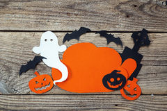 Cloud frame with ghost, pumpkin, bats, headstone cut out of pape Stock Images