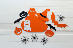 Cloud frame with ghost, pumpkins, spiders and bats cut out of pa Royalty Free Stock Photo