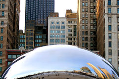 The Cloud Gate. Cloud Gate is a public sculpture by British artist Anish Kapoor in Millennium Park within the Loop community area of Chicago, Illinois, United Stock Photo