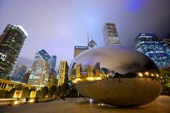 Cloud Gate Bean. Chicago, Illinois, USA - September 15, 2014: Chicago Cloud Gate sculpture and downtown Chicago skyline buildings in Millenium Park at night Royalty Free Stock Image