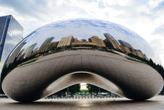 Cloud Gate in Chicago. CHICAGO, IL - Oct 6: Cloud Gate and Chicago skyline on October 6, 2011 in Chicago, Illinois. Cloud Gate is the artwork of Anish Kapoor as Stock Image