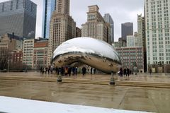 Cloud gate at Chicago Illinois Bean mirror art with people and buildings mirrored tourist landmark at this mayor USA city. Millenium Park with towering Royalty Free Stock Image