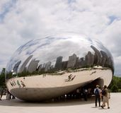 Cloud Gate with clouds Stock Photography