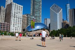Cloud Gate, the famous public sculpture, Chicago, USA. Chicago, Illinois, USA - July 12, 2013: Cloud Gate is a public sculpture by Indian-born British artist Sir royalty free stock image