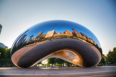 Cloud Gate sculpture in Millenium Park. CHICAGO - MAY 18: Cloud Gate sculpture in Millenium park on May 18, 2013 in Chicago, IL. It's a public sculpture by Royalty Free Stock Image