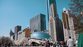 Cloud Gate Sculpture With Tourists in Millenium Park on April 30, 2015 in Chicago. Il. This Public Sculpture Is the Centerpiece of the at&t Plaza in Millennium stock footage