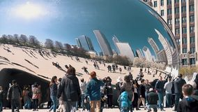 Cloud Gate Sculpture With Tourists In Millenium Park on August 5, 2015 in Chicago Illinois. Chicago - August 5: Cloud Gate Sculpture With Tourists in Millenium stock video footage