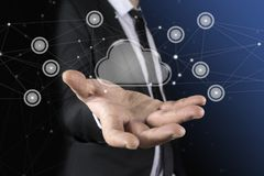 Cloud in the hand of businessman. The concept of cloud service