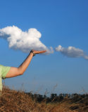Cloud in a hand of the person Stock Photography