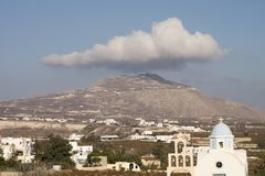 A cloud hangs over the highest point on Santorini. Island, Greece royalty free stock images