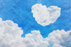 Cloud heart background with paper texture. Stock Photos