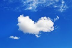 Cloud in heart shape - blue sky background - sky photo texture Stock Photography