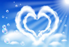 Cloud hearts in the sky. And bubbles Stock Photo
