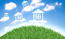 Cloud houses in the air over  field Royalty Free Stock Photography