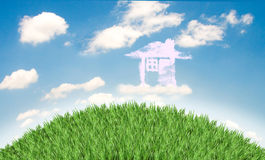 Cloud houses in the air over  field Stock Image