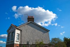 Cloud hovers above the chimneys royalty free stock images