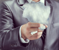 Cloud in a human hand Royalty Free Stock Image