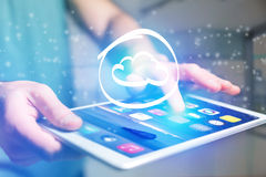 Cloud icon going out a tablet interface - technology concept Stock Photography